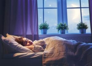child sleeping bed at night